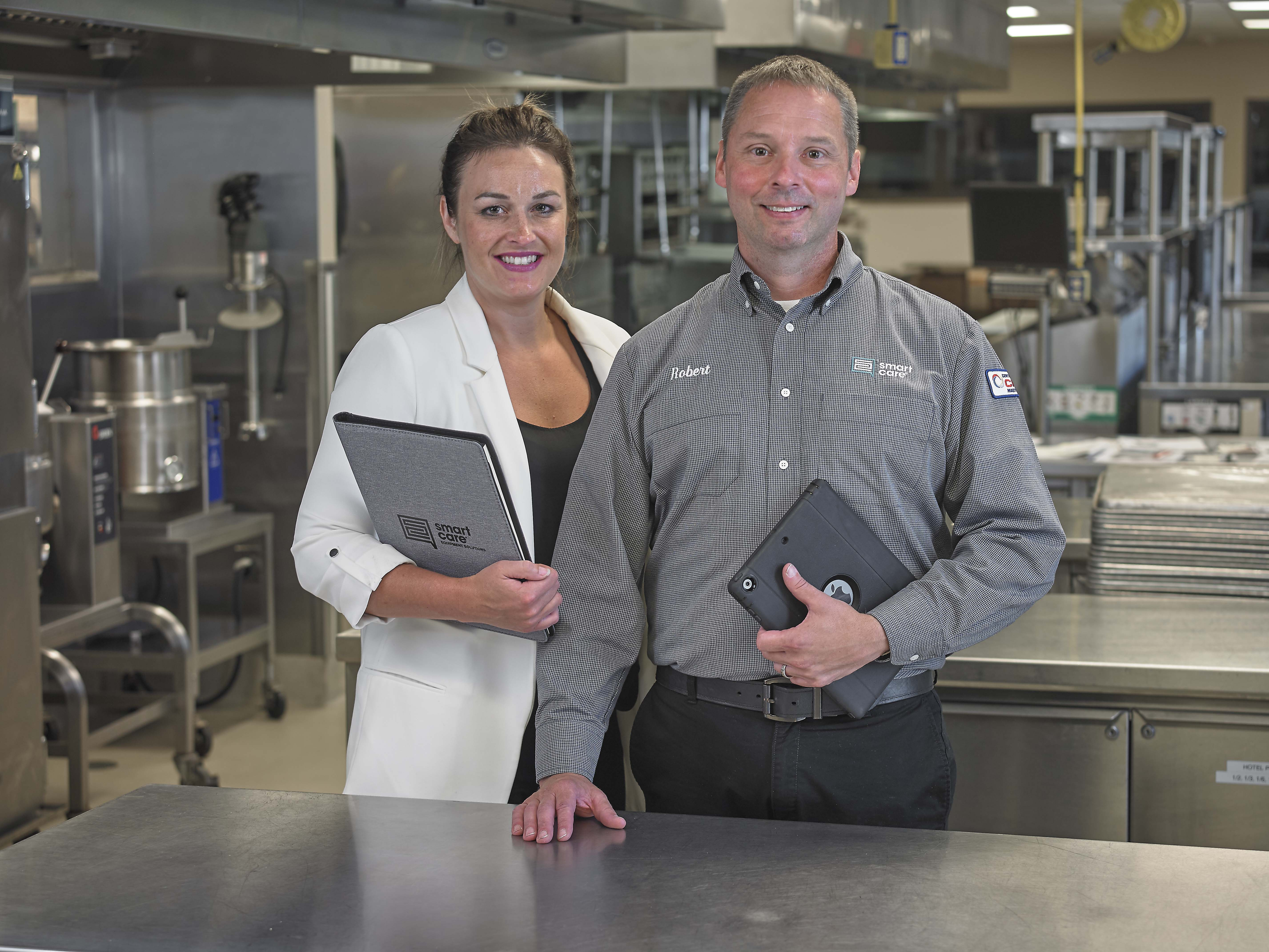 sales person and tech in kitchen